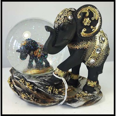 Éléphant boule de verre brillante avec gros éléphant noir
